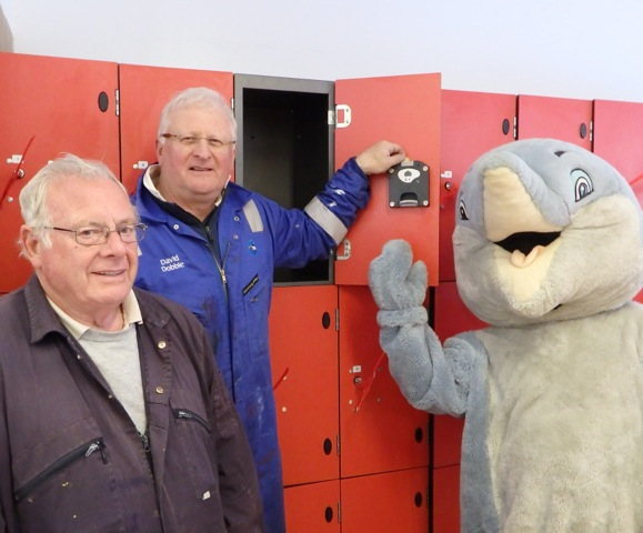 Joe Kemlo and David Dobbie show Splasher how to use the smart new locker keys